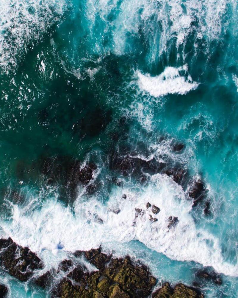 Waves crashing on rocks